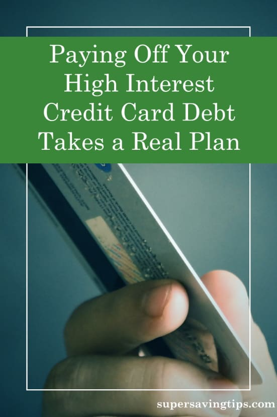 Hand holding credit card, ready to get out of credit card debt