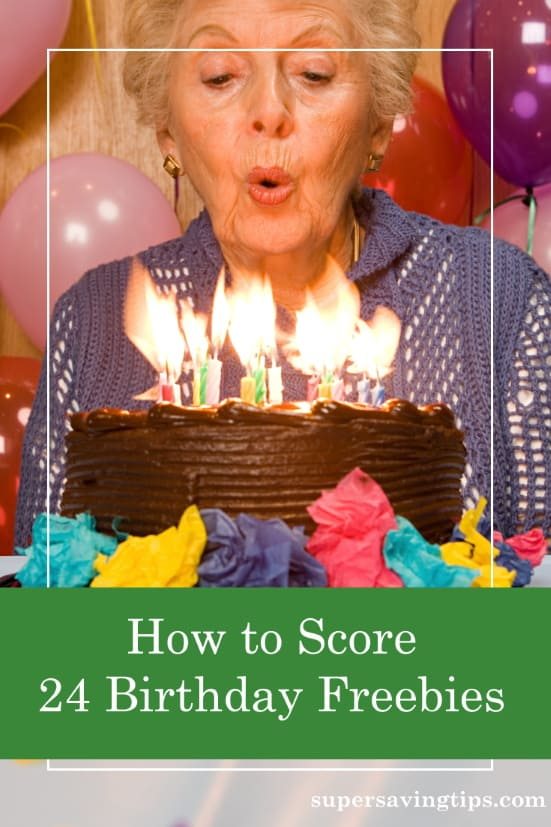 Woman blowing out candles on a birthday cake and thinking about birthday freebies